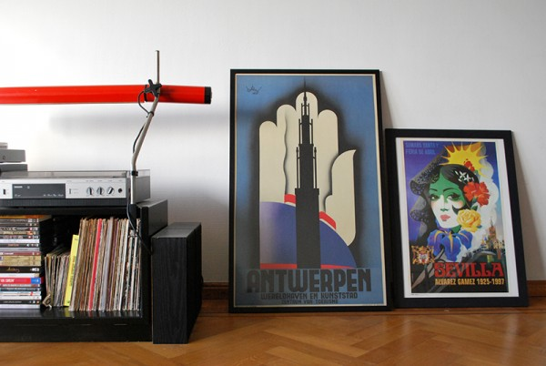 Record player, Antwerp and Sevilla posters.