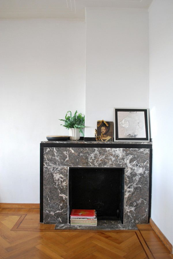 Marble fireplace, vincent van duysen pottery and 70's artwork.
