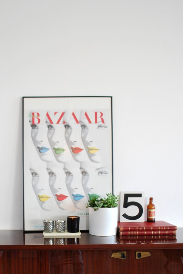 Harper's Bazaar poster, succulents and old books in a white decor.