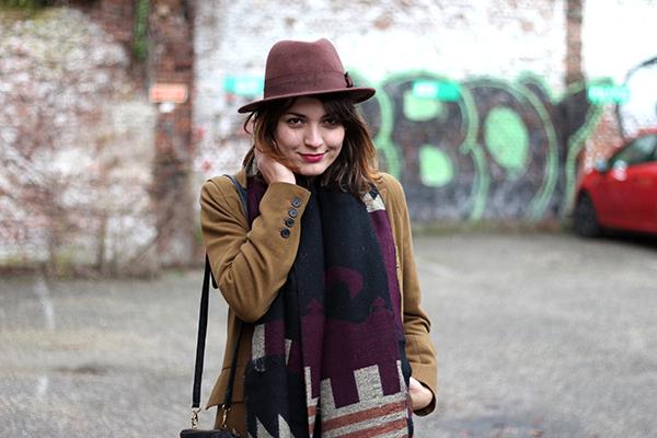 Hat, cognac coat and printed scarf