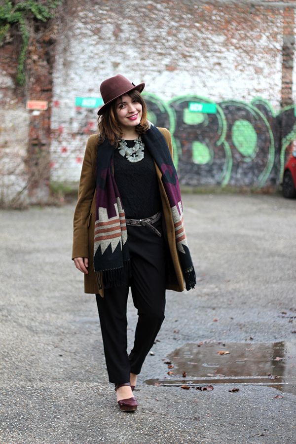 Hat, Cognac coat, statement necklace and jumpsuit