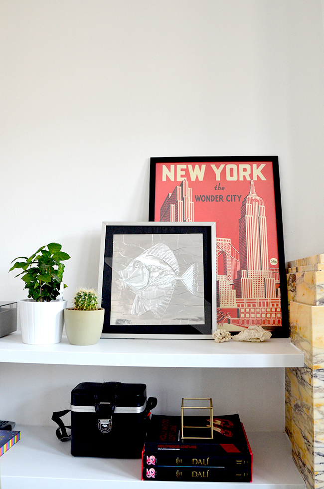 New York poster, fish artwork & open shelving via noglitternoglory.com