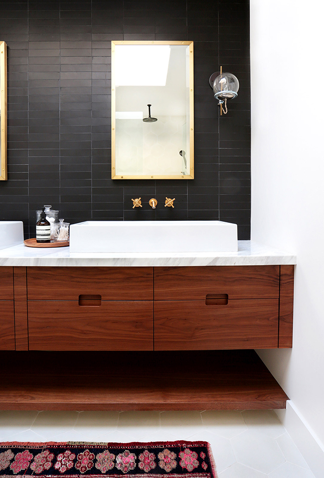 Black, white and brass bathroom by amber interiors