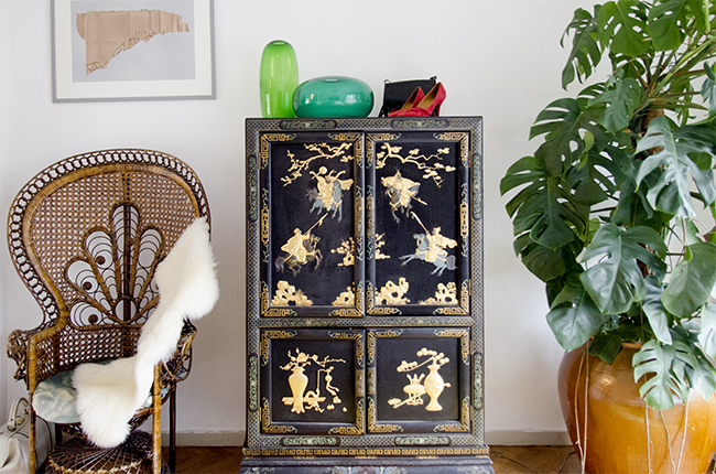 Nathalie and Michiel's Arty & Eclectic Apartment // peacock chair and chinese credenza