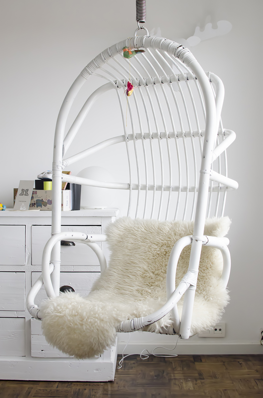 Young Creatives: Melanie Van Dooren //Inside the home and workplace of a Jewelry Designer // Rotan hanging chair