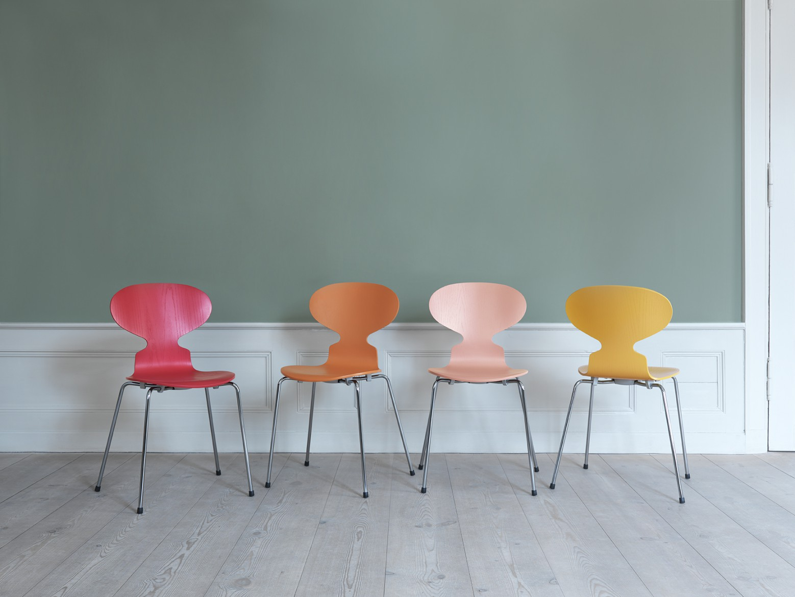 Designer profile Arne Jacobsen // coloured, red, orange, pink, yellow, Ant chairs - via noglitternoglory